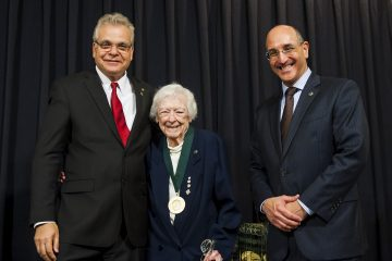 Dr. E. McGeer and Dr. P. McGeer receiving their medals for being named  2015 National Academy of Inventors Fellows